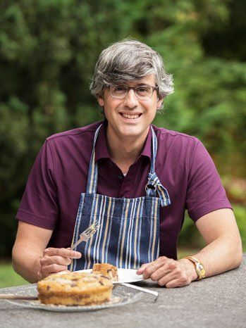 Mo Rocca with cake