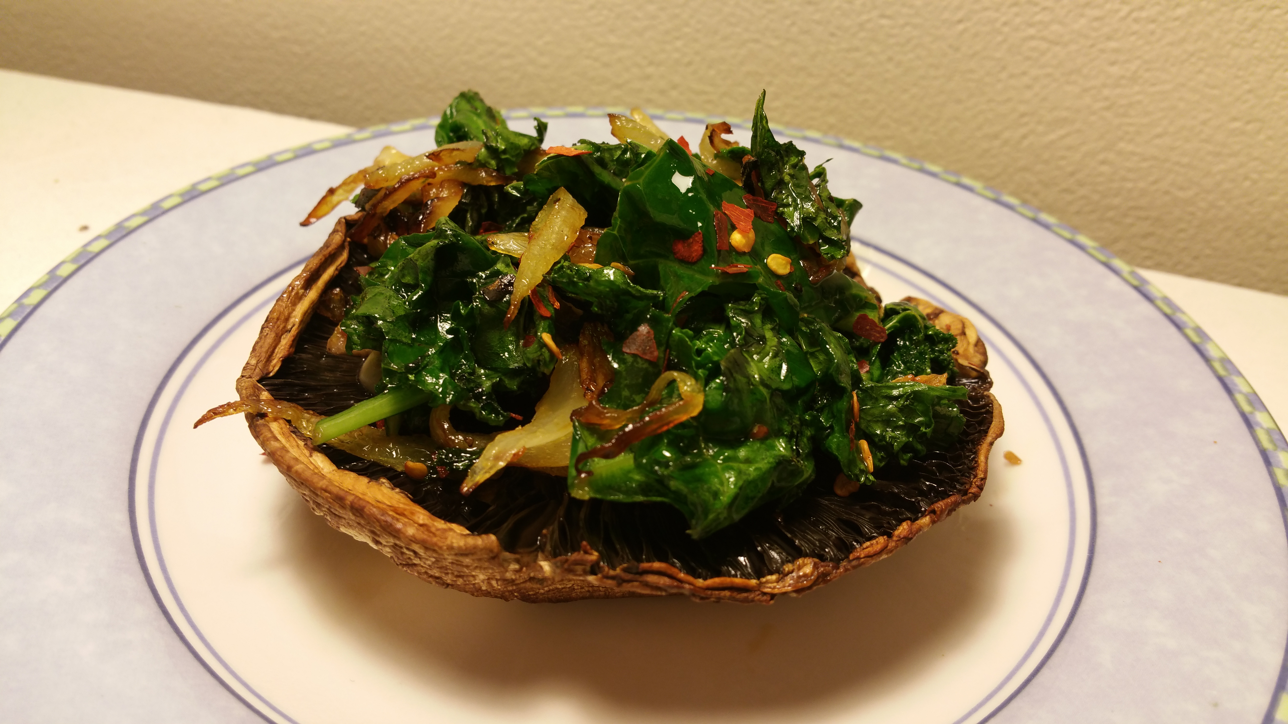 portabella mushroom with kale and onions